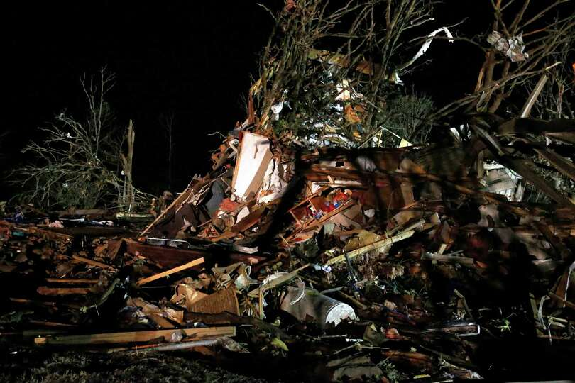 Debris is scattered in what was a mobile home park where a tornado struck near Dale, Okla., Sunday,
