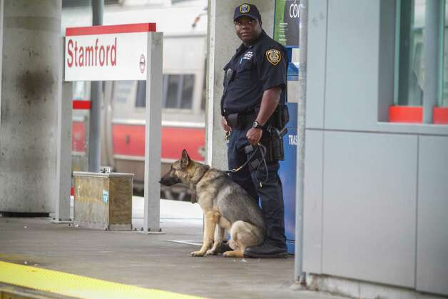 An Metropolitan Transportation Administration police officer stands ona New York-bound platform at the Stamford's Stewart B. MicKinney Transportation Center on Monday, May 20, 2013. The Metro-North railroad is provided extra assistance to commuters at the Stamford train station because disrupted service between South Norwalk and Bridgeport after the collision of two trains on Friday, May 17. Photo: Chris Preovolos/Hearst Newspapers / 2011