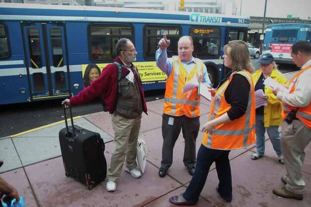 A commuters talks to Metro-North employees at the Stamford's Stewart B. MicKinney Transportation Center on Monday, May 20, 2013. The Metro-North railroad is provided extra assistance to commuters at the Stamford train station because disrupted service between South Norwalk and Bridgeport after the collision of two trains on Friday, May 17. Photo: Chris Preovolos/Hearst Newspapers / 2011