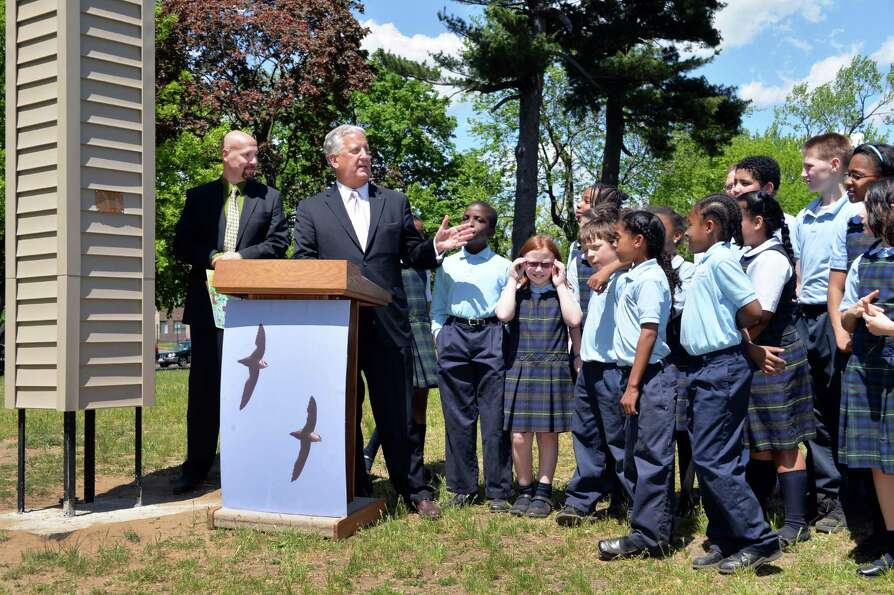 Audubon New York's Rich Merritt, left, Mayor Jerry Jennings and 5th Graders from Blessed Sacrament S