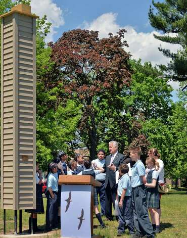 Mayor Jerry Jennings and 5th Graders from Blessed Sacrament School at the unveiling of a 16? Chimney Swift tower, at far left, at Swinburne Park in Albany NY Thursday May 16, 2013. Chimney Swifts winter in South America and breed in urban areas in the Eastern United States.  (John Carl D'Annibale / Times Union) Photo: John Carl D'Annibale / 00022390A