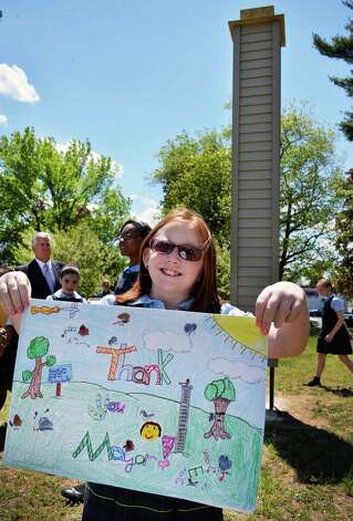 5th Graders from Blessed Sacrament School Grace Ryan holds a thank you note from Mayor Jerry Jennings during a ceremony to unveil a 16? Chimney Swift tower, at far left, at Swinburne Park in Albany NY Thursday May 16, 2013. Chimney Swifts winter in South America and breed in urban areas in the Eastern United States.  (John Carl D'Annibale / Times Union) Photo: John Carl D'Annibale / 00022390A