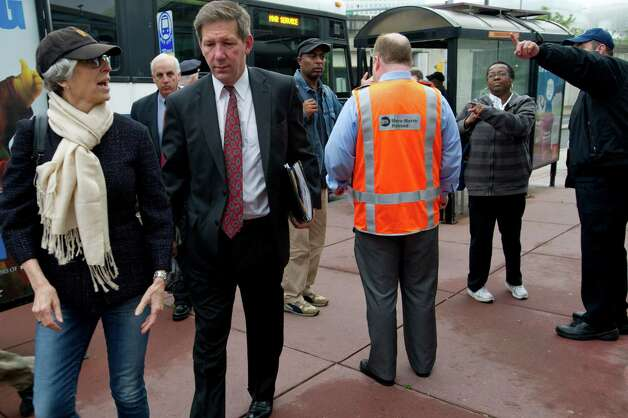 Commuters disembark a bus from Bridgeport at the train station in Stamford, Conn., on Monday, May 20, 2013. Customer Service Representatives, wearing orange vests, were on hand to answer questions from the passengers. Photo: Lindsay Perry / Stamford Advocate