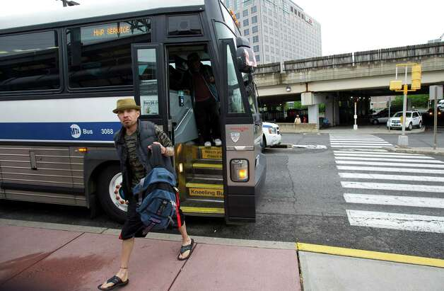 Alfred Arrieta gets off a bus from Brideport at the train station in Stamford, Conn., on Monday, May 20, 2013. Photo: Lindsay Perry / Stamford Advocate