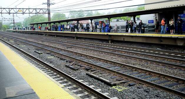 Commuters wait on the platform for a train at the station in Greenwich, Conn., on Monday, May 20, 2013. Photo: Lindsay Perry / Stamford Advocate