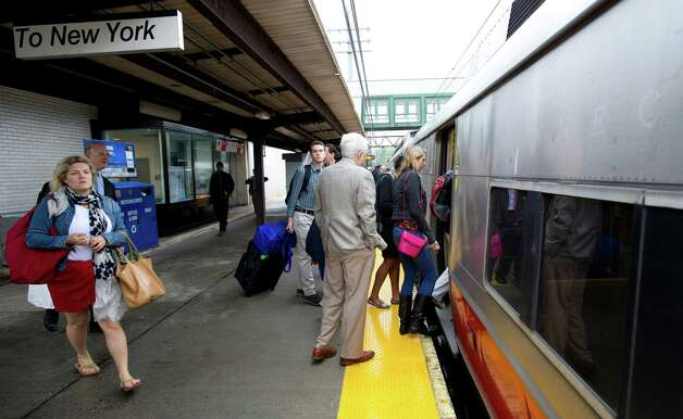 Commuters board a train for Grand Central station in Greenwich, Conn., on Monday, May 20, 2013. Photo: Lindsay Perry / Stamford Advocate