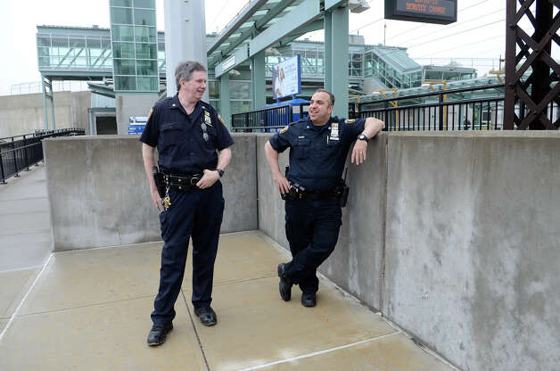 "Metropolitan Transportation Authority police officers Thomas O'Halloran, left, and Freddy Sanchez keep watch over the Fairfield Metro train station on Monday morning, May 20, 2013. With no train service due to Friday's crash, commuters were instead taking buses to Westport. The officers were there to ""make sure everything runs smoothly,"" said O'Halloran. The station was unusually quiet. Photo: Shelley Cryan / Shelley Cryan for the CT Post/ freelance Shelley Cryan"