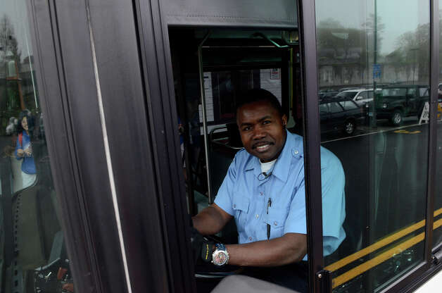 Bus driver Prospere Walter, Fairfield, transports commuters between the Fairfield and Westport train stations around 6:30am on Monday morning, May 20, 2013. Walter had reported to work at 4:30am to help commuters who usually rely on the train, which was not in service in Fairfield, CT. Photo: Shelley Cryan / Shelley Cryan for the CT Post/ freelance Shelley Cryan