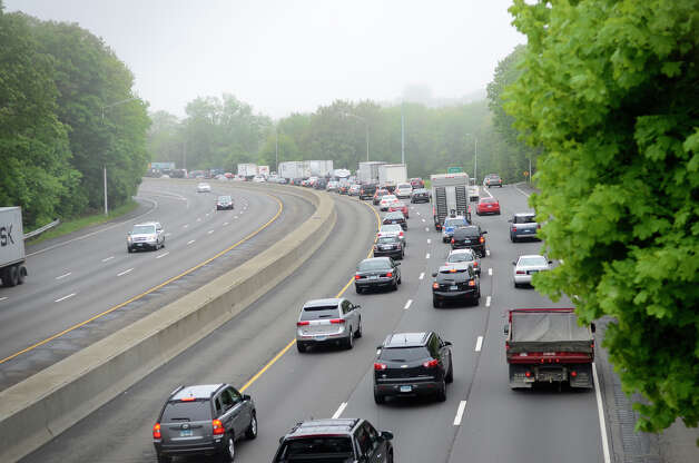 Southbound traffic in I-95, right, is heavy just after 8am on Monday, May 20, 2013, as commuters contend with the lack of train service in Fairfield due to Friday's train crash. Photo: Shelley Cryan / Shelley Cryan for the CT Post/ freelance Shelley Cryan
