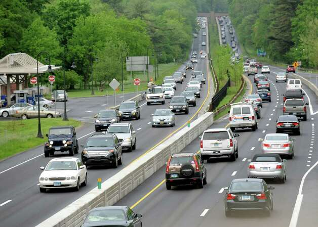 Dispite the limited trains into New York City traffic southbound on the Merritt Parkway at exit 46 was heavy but moving at 7:45 am. Photo: Cathy Zuraw / Connecticut Post