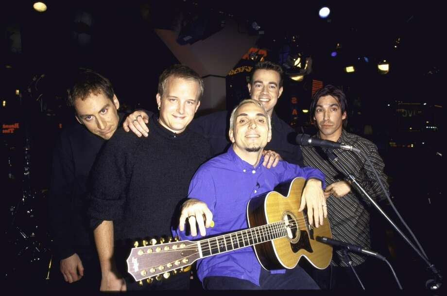 MTV VJ Carson Daly (2nd R) with members of rock band Everclear (L-R) Greg Eklund, Art Alexakis and Craig Montoya.