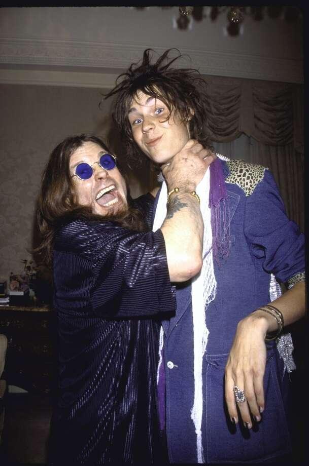 Rock musician Ozzy Osbourne and MTV VJ Jesse Camp.