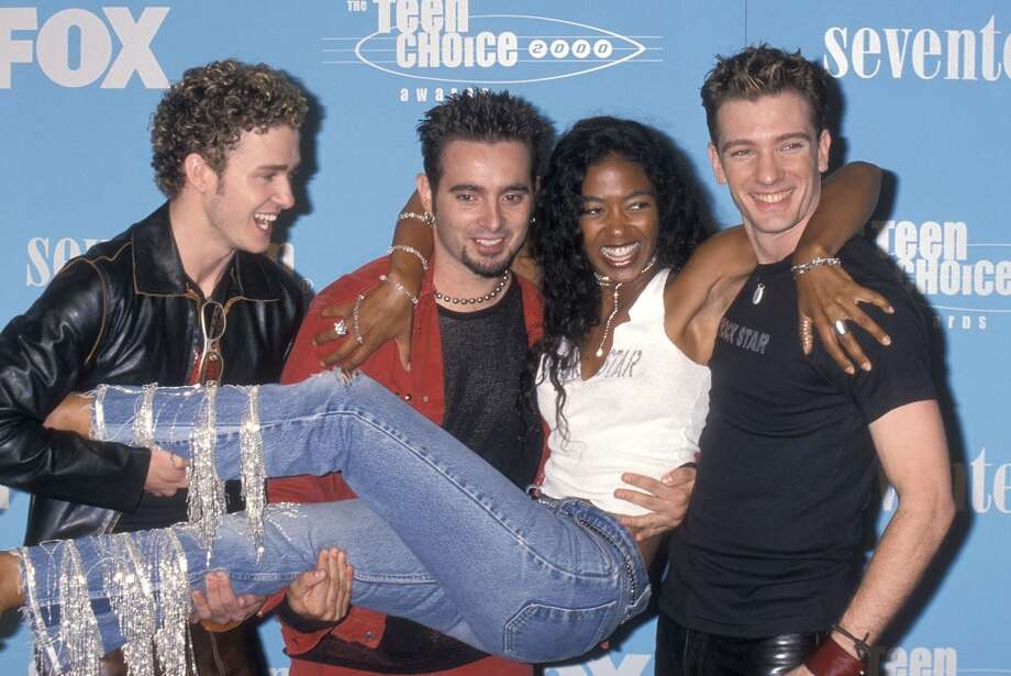 Singers Justin Timberlake, Chris Kirkpatrick and JC Chasez of NSYNC and MTV VJ Ananda Lewis attend the Second Annual Teen Choice Awards on August 6, 2000.