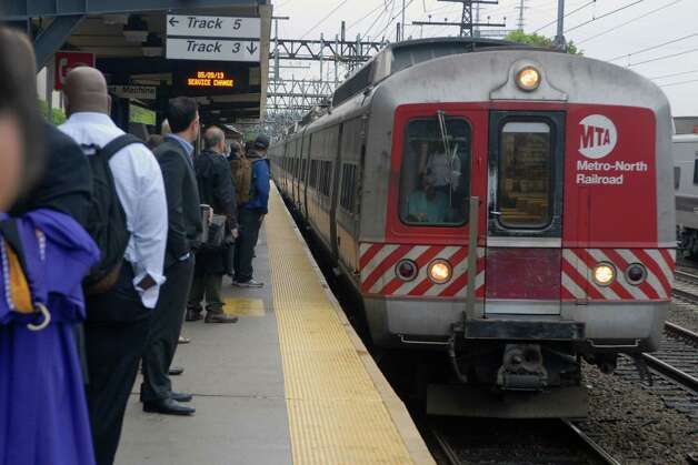 Commuters board Metro North train from South Norwalk, Conn. to New York on Monday May 20, 2013. Photo: Dru Nadler / Stamford Advocate Freelance