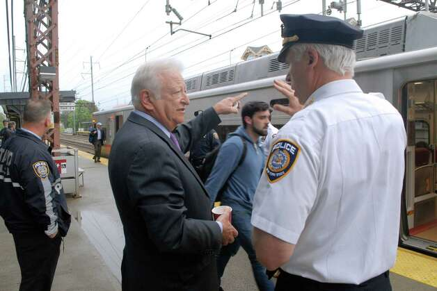 Norwalk mayor Richard Moccia speaks with MTA police chief Mike Coan at  the South Norwalk, Conn. train station on Monday May 20, 2013. Photo: Dru Nadler / Stamford Advocate Freelance