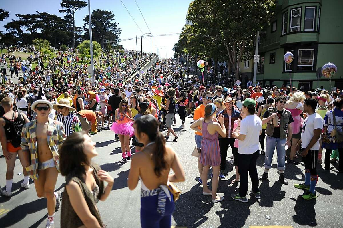Crowds of race participants crowd into Alamo Square Park on Hayes St. during the 102nd Bay to Breakers race in San Francisco, CA Sunday May 19th, 2013.