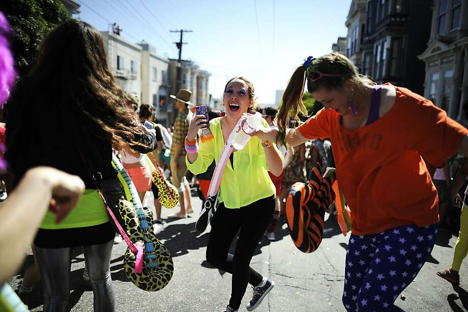 Paige Popdan(center) from New York dances with friends on Hayes St. during the 102nd Bay to Breakers race in San Francisco, CA Sunday May 19th, 2013. Photo: Michael Short, Special To The Chronicle