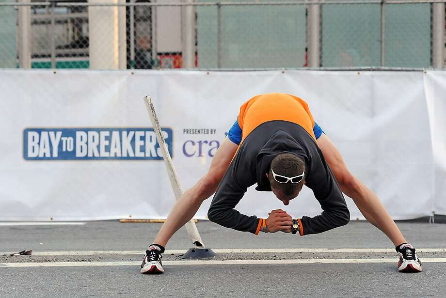 Runner Craig Schmidt of San Jose Stretches before the start of the 102nd Bay to Breakers race in San Francisco, CA Sunday May 19th, 2013. Photo: Michael Short, Special To The Chronicle