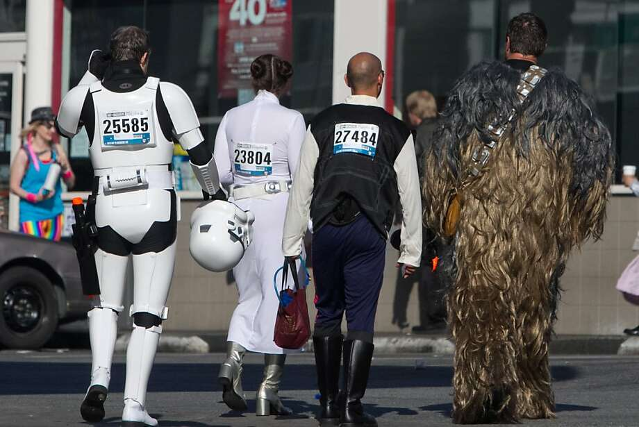 Participants dressed in Star Wars outfits take a quick break at a convenience store at 9th and Howard during the 2013 Bay to Breakers in San Francisco, Calif. on May 19, 2013. Photo: Douglas Zimmerman, SF Gate