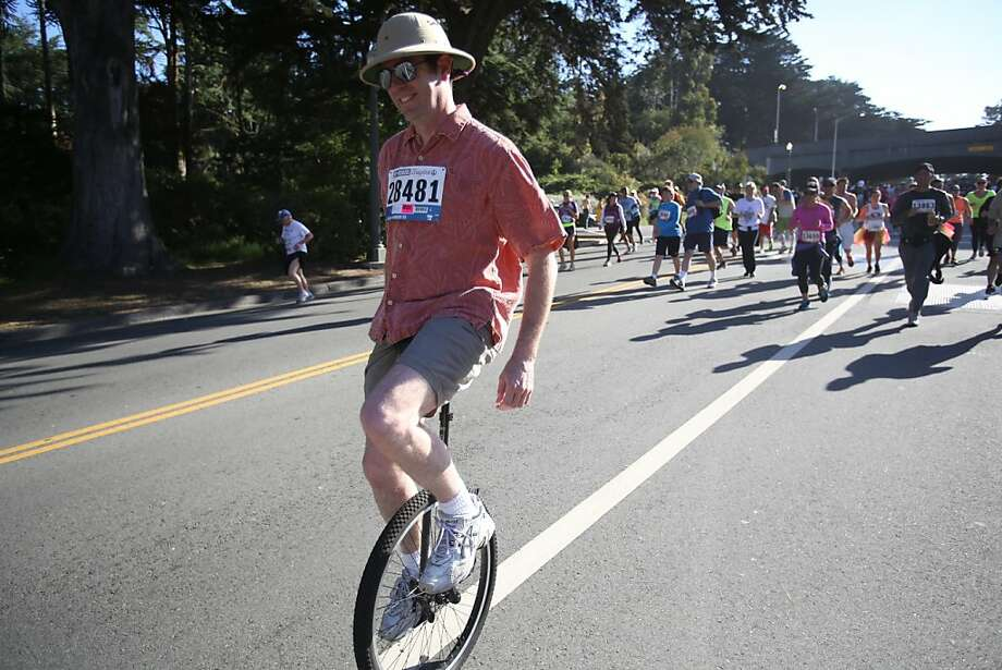 A unicyclist rides down JFK Jr. Dr. during the Bay to Breakers in San Francisco on Sunday, May 19, 2013. Photo: Mathew Sumner, Special To The Chronicle