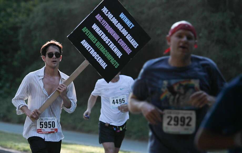 A runner impersonates local personality Frank Chu in the Bay to Breakers in San Francisco on Sunday, May 19, 2013. Photo: Mathew Sumner, Special To The Chronicle