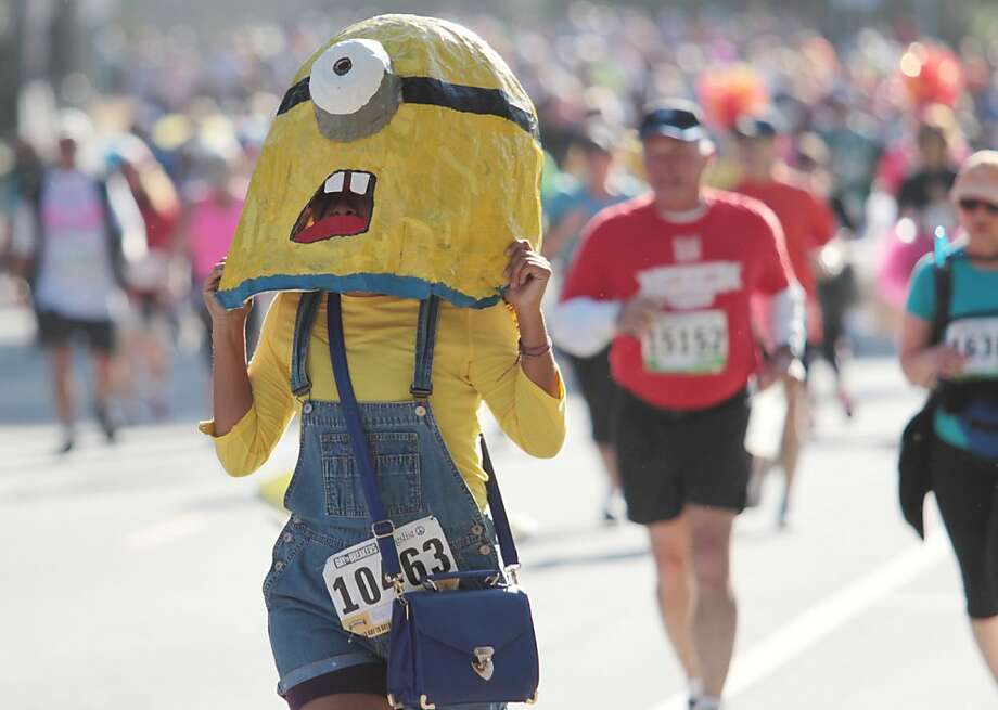 "A runner dressed as a minion from ""Despicable Me"" runs through Golden Gate Park during the Bay to Breakers in San Francisco on Sunday, May 19, 2013. Photo: Mathew Sumner, Special To The Chronicle"