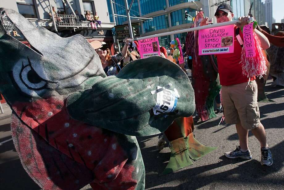 The school  spawning salmon head under a limbo stick while heading against the crowd at the 2013 Bay to Breakers in San Francisco, Calif. on May 19, 2013. Photo: Douglas Zimmerman, SF Gate