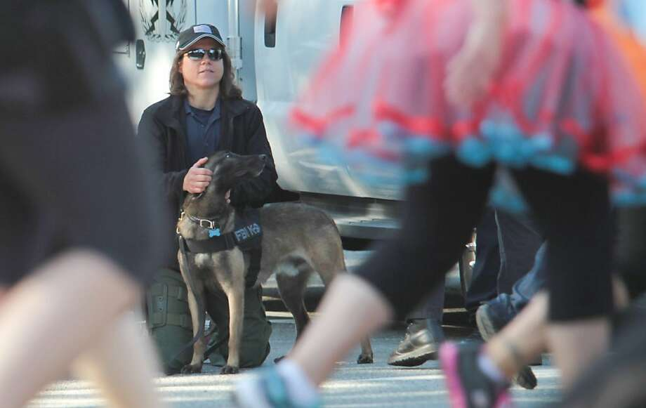 For the first time in the history of the Bay to Breakers, the FBI posted an explosive detection K-9 unit, Jet, and a handler on the course in San Francisco on Sunday, May 19, 2013. Photo: Mathew Sumner, Special To The Chronicle
