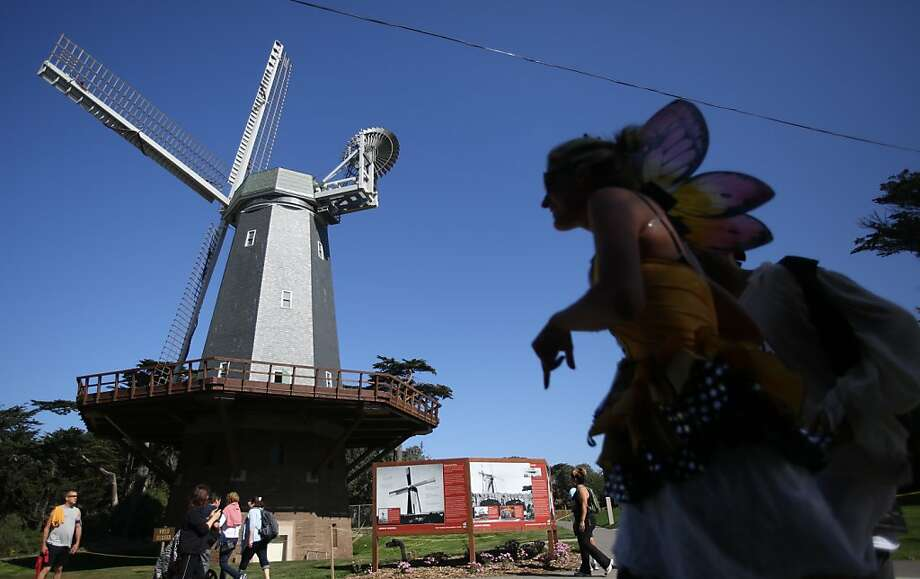 A participant walks past a windmill in Golden Gate Park during the Bay to Breakers in San Francisco on Sunday, May 19, 2013. Photo: Mathew Sumner, Special To The Chronicle