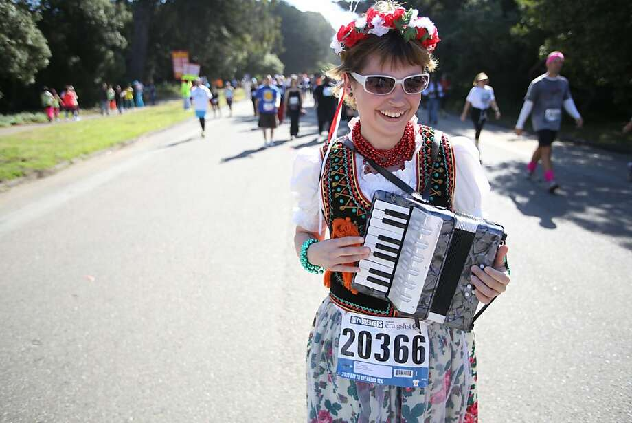 Erin Campbell plays an accordion during the Bay to Breakers in San Francisco on Sunday, May 19, 2013. Photo: Mathew Sumner, Special To The Chronicle