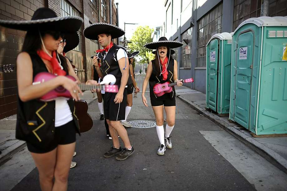 Mariachi's wait in line to use a set of porta potty's during the 102nd Bay to Breakers race in San Francisco, CA Sunday May 19th, 2013. Photo: Michael Short, Special To The Chronicle
