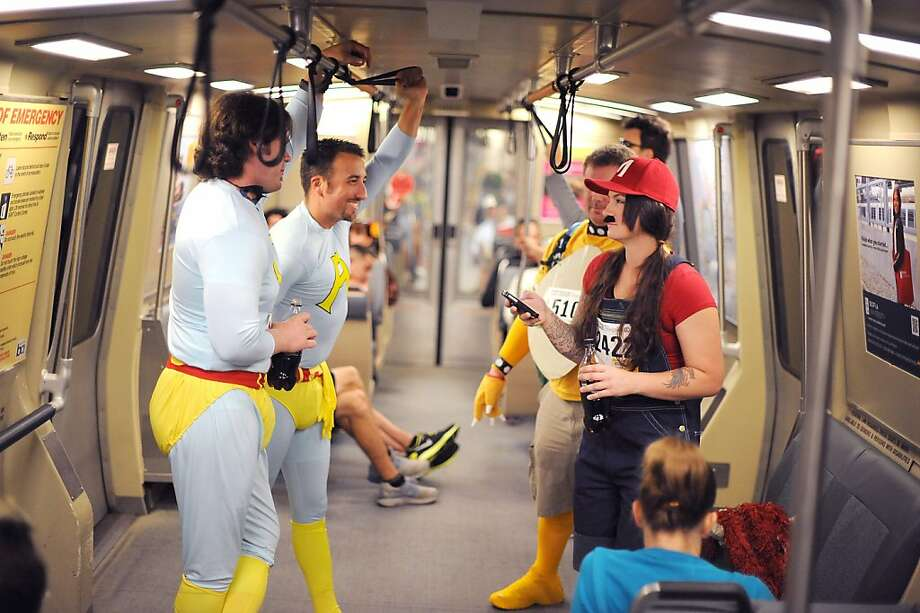 (L_R)Greg McPheter, Mason McDuffie, Jackson Coats and Jamie Predmore are seen taking BART from the East Bay on their way to the 102nd Bay to Breakers race in San Francisco, CA Sunday May 19th, 2013. Photo: Michael Short, Special To The Chronicle