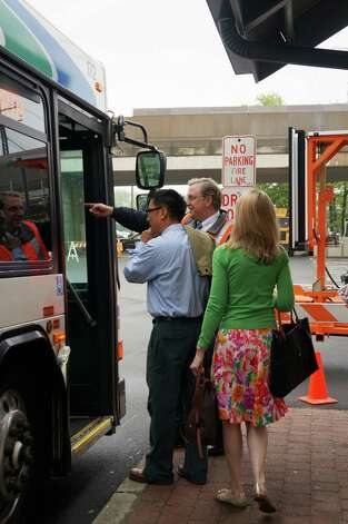 Commuters in downtown Fairfield board a bus to the Westport station, where they could catch a southbound train. Photo: Genevieve Reilly / Fairfield Citizen