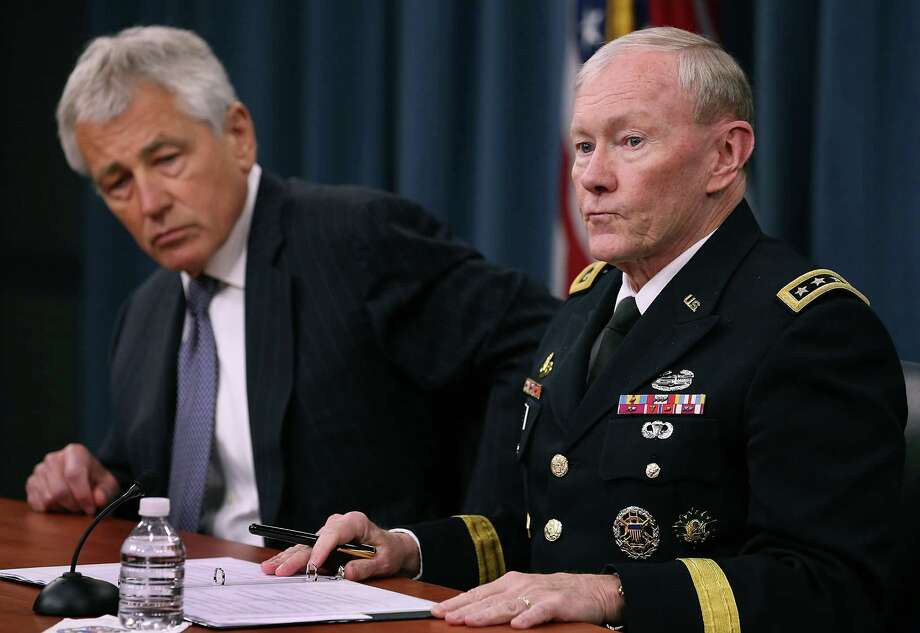 Secretary of Defense Chuck Hagel (L) and Chairman of the Joint Chiefs of Staff Gen. Martin E. Dempsey listen to questions during a media briefing at the Pentagon, May 17, 2013 in Arlington, Vir.  Secretary Hagel spoke about sexual assault in the military and the situation in Syria. Photo: Mark Wilson, Getty Images / 2013 Getty Images