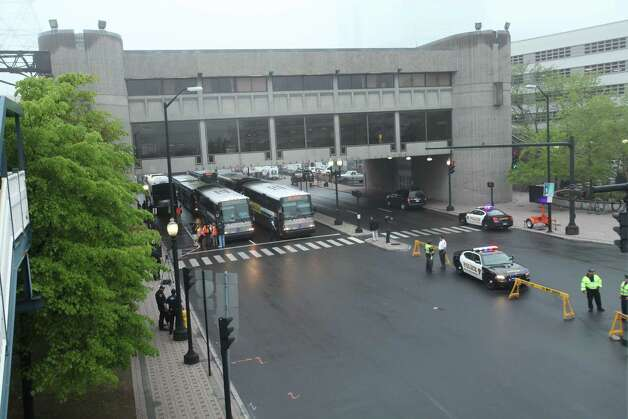 Lines of buses wait  on Water Street in Bridgeport to take commuters to Stamford and other locals while train service is suspended on Monday, May 20, 2013. There was no train service from Bridgeport to South Norwalk because of a train collision on Friday. Photo: BK Angeletti, B.K. Angeletti / Connecticut Post freelance B.K. Angeletti