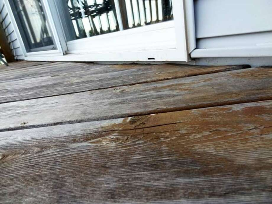 "Deck Rydmark advises homeowners to inspect their decks for rotting wood. Water dripping off the roof onto the deck can cause rotting, as can leaves that get wedged between the bottom of the patio door and the deck. ""A small piece of rotted wood can lead to big pieces of rotted wood,"" he says. 