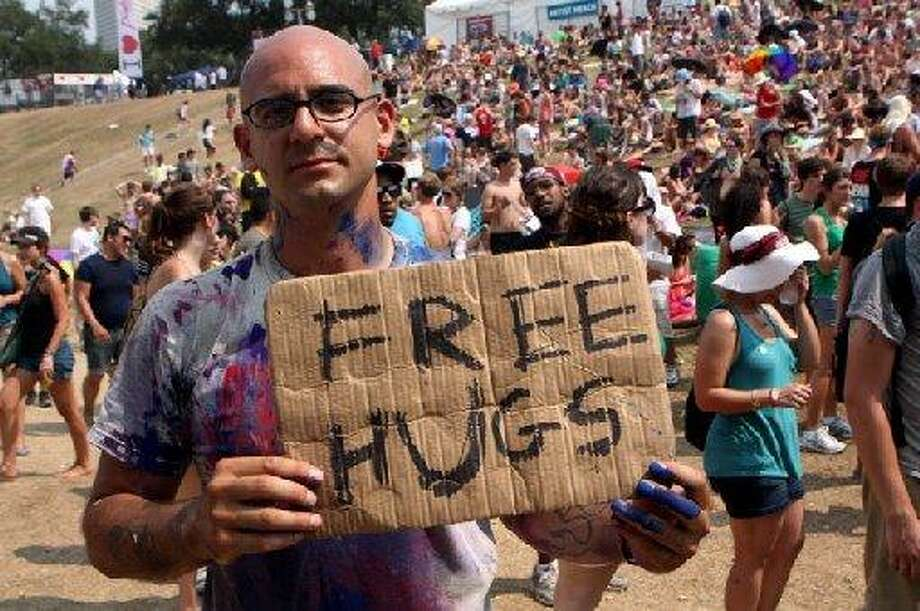 Free hug guy. Photo: Chron File.