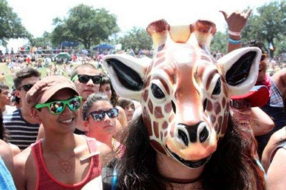 Creepy people in masks. Photo: Chron File