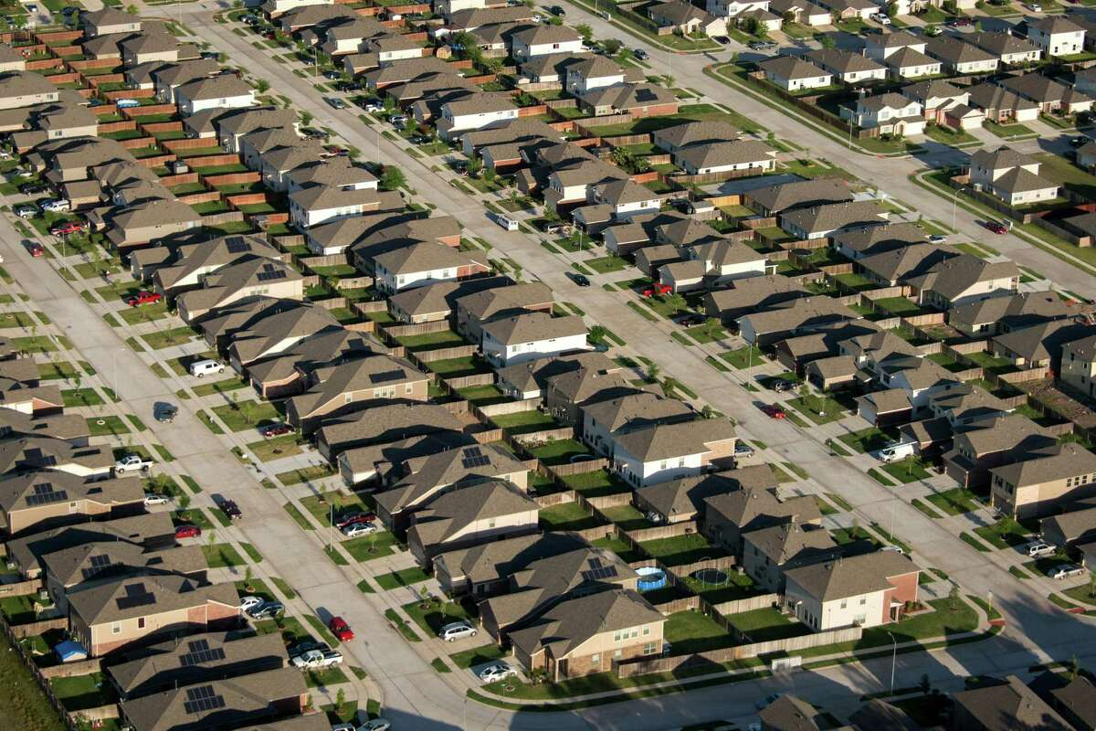 A subdivision in north Houston. Freeways such as the Grand Parkway have prompted developers to convert absorbent open land - fields and prairies - into much less absorbent suburbs, leaving floodwater to rush downstream.