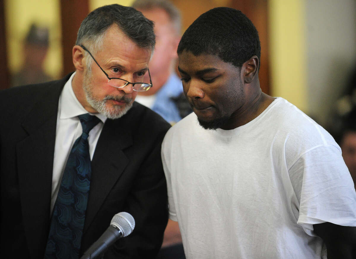 Standing with his lawyer, John R. Gulash, left, Jermaine Richards is arraigned on murder charges in the death of ECSU student Alyssiah Marie Wiley at Superior Court in Bridgeport, Conn. on Monday, May 20, 2013.