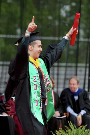 Sacred Heart University graduate Javier Vadir of Flushing, NY celebrates after receiving his diploma  during SHU commencement ceremony in Fairfield, Conn. on Sunday May 19, 2013. Photo: Mike Ross / Connecticut Post contributed