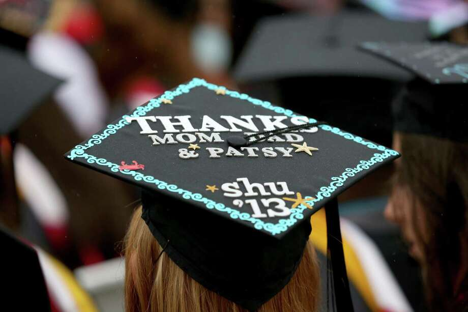 A Sacred Heart University graduate wears a mortarboard with message thanking parents during SHU commencement ceremony in Fairfield, Conn. on Sunday May 19, 2013. Photo: Mike Ross / Connecticut Post contributed