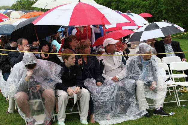 Spectators at Fairfield University's 63rd commencement endured less-than-ideal conditions Sunday, but this group was prepared for the weather. Photo: BK Angeletti, B.K. Angeletti / Connecticut Post freelance B.K. Angeletti