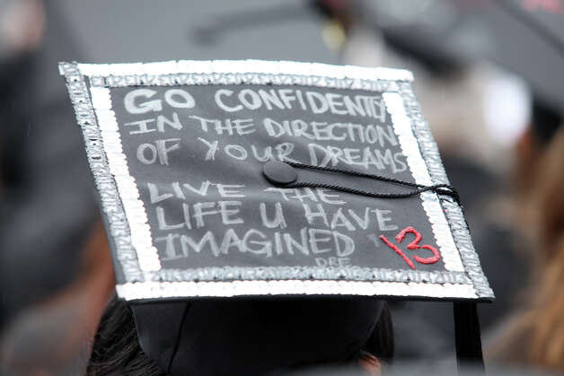 This mortarboard offered advice to the Class of 2013 at Fairfield University's commencement on Sunday. Photo: BK Angeletti, B.K. Angeletti / Connecticut Post freelance B.K. Angeletti