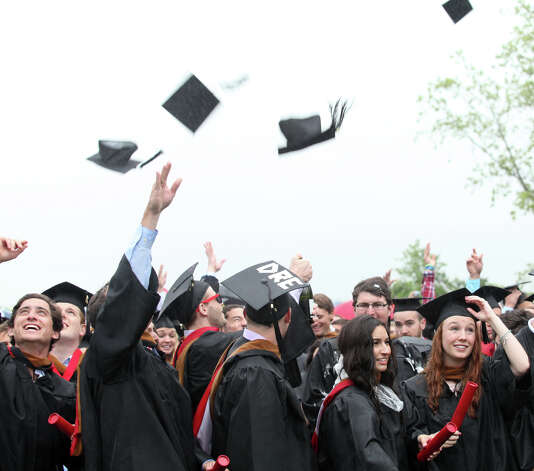 Fairfield University's newest graduates celebrate at the conclusion of the 63rd Commencement ceremony on Sunday, May 19, 2013. Photo: BK Angeletti, B.K. Angeletti / Connecticut Post freelance B.K. Angeletti