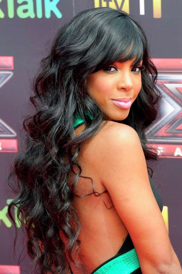 U.S. singer Kelly Rowland poses for photographers at the press launch, for the British version of X Factor at a central London venue, Wednesday, Aug. 17, 2011. Photo: Jonathan Short