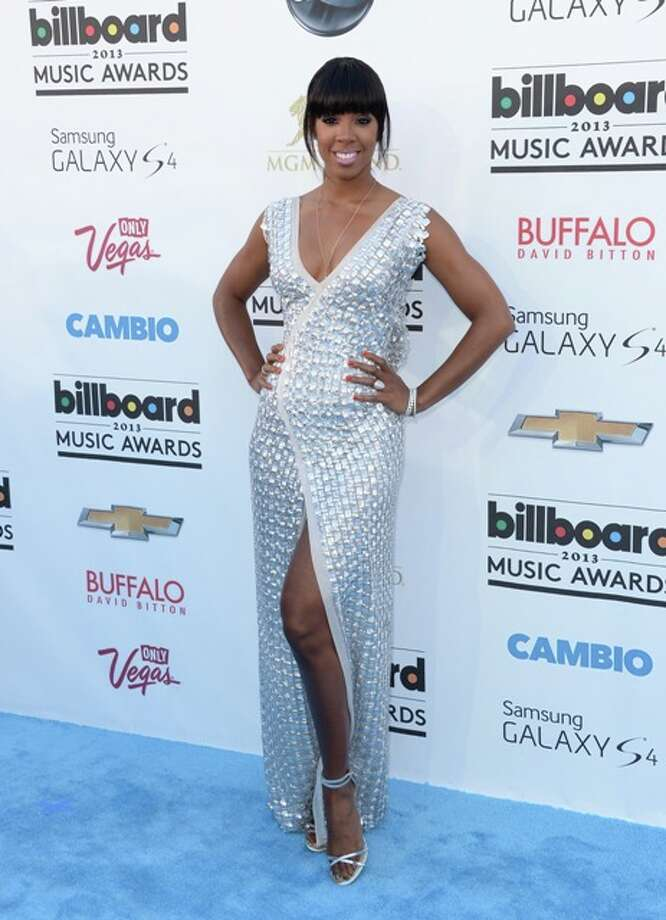 Singer Kelly Rowland arrives at the 2013 Billboard Music Awards at the MGM Grand Garden Arena on May 19, 2013 in Las Vegas, Nevada. Photo: Jason Merritt / 2013 Getty Images