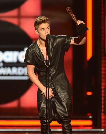 "Singer Justin Bieber grabs his crotch while accepting the award for ""Top Male Artist"" onstage during the 2013 Billboard Music Awards at the MGM Grand Garden Arena on May 19, 2013 in Las Vegas, Nevada."