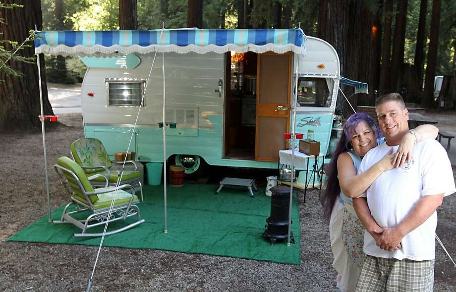 "Penny Cotter, and her husband Charlie Nienow have restored a 1962 Shasta Airflyte trailer to its original glory. Nicknamed the ""canned ham"" aficionados. The canned ham is the iconic trailer of the 50s and 60s, and is often set it up at Smithwoods RV park in Felton Calif. Tuesday, May 14, 2013 in Felton, Calif. Photo: Lance Iversen, The Chronicle"