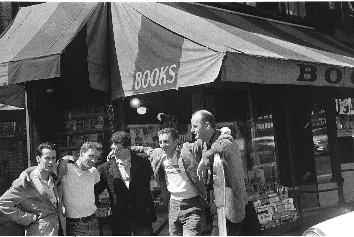 Bob Donlon (left), Neal Cassady, Allen Ginsberg, Robert La Vigne and Lawrence Ferlinghetti, whose City Lights bookstore in San Francisco is behind them, in 1956.